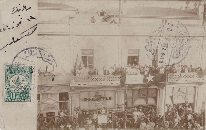 A photocard from the summer of 1908, possibly showing celebrations in the city of Salonica in support for the Young Turk Revolution that happened just a month before, with the discontent and rebellion starting within the locally based 3rd Army Corps in the Ottoman sancak of Macedonia, of which Salonica was the capital.
